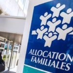 A woman walks past a branch of the Caisse d'Allocations Familiales (Family Allocations Office, or CAF) in Calais on April 15, 2015.   AFP PHOTO PHILIPPE HUGUEN / AFP PHOTO / PHILIPPE HUGUEN